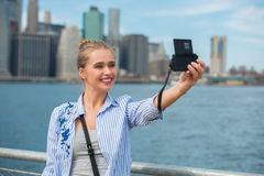 Beautiful fashion beauty woman blogger taking selfie photo and video in New York City.  royalty free stock photos
