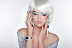 Beautiful fashion blond girl with bob hair. Makeup. Jewelry. Stock Image