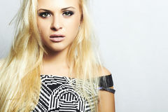 Beautiful fashion blond woman in dress.beauty girl.make-up Stock Photography