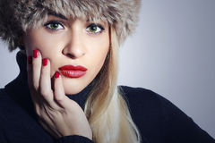 Beautiful Fashion Blond Woman in Fur. Beauty Girl. Winter Style. Red Manicure. Make-up Royalty Free Stock Photo