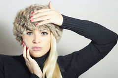 Beautiful Fashion Blond Woman in Fur. Beauty Girl. Winter Style. Red Manicure. Make-up Royalty Free Stock Photography