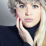Beautiful Fashion Blond Woman in Fur. Beauty Girl. Winter Style. Red Manicure. Make-up Stock Photos