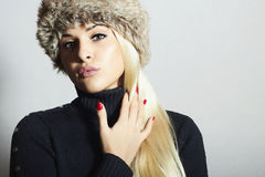 Beautiful Fashion Blond Woman in Fur. Beauty Girl. Winter Style. Red Manicure. Make-up Stock Photo