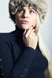 Beautiful Fashion Blond Woman in Fur. Beauty Girl. Winter Style. Red Manicure. Make-up Stock Image