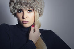 Beautiful Fashion Blond Woman in Fur Hat. Winter Girl Stock Photography