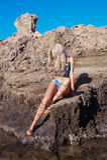 Beautiful fashion blonde at the seashore. Beautiful sensual blonde in a greek sandals at the seashore. Summer travel fashion photo royalty free stock photo