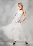 Beautiful fashion blonde  in white dress Stock Image
