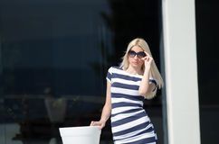 Beautiful fashion blonde woman wear sunglasses Stock Image