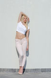 Beautiful fashion blonde woman wear top and jean Royalty Free Stock Photo
