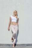 Beautiful fashion blonde woman wear top and jean Royalty Free Stock Photography