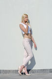 Beautiful fashion blonde woman wear top and jean Royalty Free Stock Images