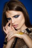 Beautiful fashion close-up portrait of girl who sniffs sequins Royalty Free Stock Photos