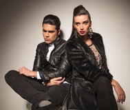 Beautiful fashion couple sitting together Stock Photography