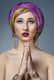 Beautiful fashion east  woman portrait.Asian girl in a black hea Stock Photos