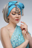 Beautiful fashion east  woman portrait with oriental accessories Royalty Free Stock Photography