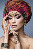 Beautiful fashion east  woman portrait with oriental accessories Stock Photography