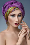 Beautiful fashion east  woman portrait with oriental accessories Royalty Free Stock Photo