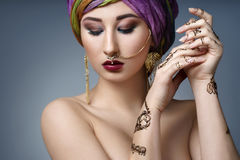 Beautiful fashion east  woman portrait with oriental accessories Stock Images
