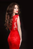 Beautiful fashion elegant woman in red dress isolated on black b Royalty Free Stock Image
