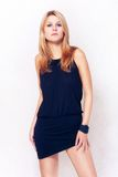 Beautiful fashion girl. Attractive beautiful fashion blond girl in black clothes Stock Image