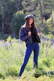 Beautiful fashion girl on background of countryside Stock Photo