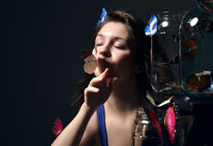 Beautiful fashion girl with butterflies Stock Image
