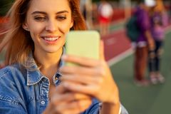 Beautiful fashion girl doing selfie with phone at sunset.  stock photos