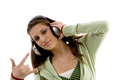 Beautiful fashion girl enjoying music Royalty Free Stock Images