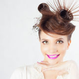 Beautiful Fashion Girl Face with Fancy Hairstyle, Colorful Nail Polish royalty free stock image