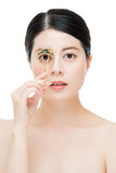 Beautiful fashion girl holding eyelash curler makeup accessory Royalty Free Stock Photos
