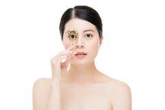 Beautiful fashion girl holding eyelash curler makeup accessory Royalty Free Stock Photography