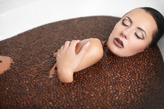Beautiful fashion girl in jacuzzi with coffee Royalty Free Stock Photography