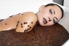 Beautiful fashion girl in jacuzzi with coffee stock image