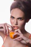 Beautiful fashion girl with mandarin Stock Images