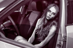 beautiful fashion girl model sitting in the car Royalty Free Stock Photo