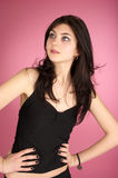 Beautiful fashion girl over pink Royalty Free Stock Image