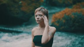 Girl in tropical rain forest jungle stock footage
