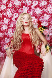Beautiful Fashion Girl with red makeup and Roses. Royalty Free Stock Images