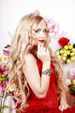 Beautiful Fashion Girl with red makeup and Roses. Royalty Free Stock Photo