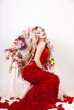 Beautiful Fashion Girl with red makeup and Roses. Hairstyle Royalty Free Stock Images