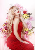 Beautiful Fashion Girl with red makeup and Roses. Hairstyle Royalty Free Stock Photography