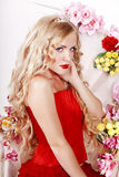 Beautiful Fashion Girl with red makeup and Roses. Stock Photos