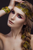 Beautiful fashion girl in a scarf and bracelets Stock Images