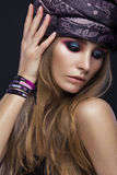 Beautiful fashion girl in a scarf and bracelets Stock Image