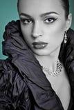 Beautiful fashion girl on the turquoise background Royalty Free Stock Image