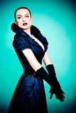 Beautiful fashion girl on the turquoise background Royalty Free Stock Images