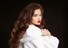 Beautiful Fashion Girl in White Mink Fur Coat. Makeup. Winter po Royalty Free Stock Photography