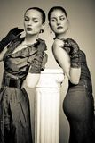 Beautiful fashion girls on the grey background Royalty Free Stock Image