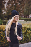 Beautiful fashion girls outdoor. Beautiful model walks through the city in a beautiful hat and glassesr Stock Photos