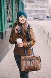 Beautiful fashion girls outdoor. Beautiful model walks through the city in a beautiful hat and glassesr Royalty Free Stock Photography